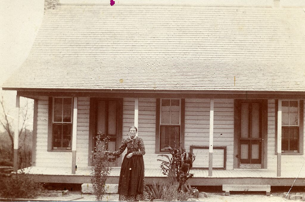 Ch. 6 Artemissa McF. in front of new house1897